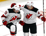 New Jersey Devils center Blake Coleman (20) celebrates his goal with teammate John Quenneville (47) during the third period of an NHL hockey game against the Boston Bruins, Thursday, Dec. 27, 2018, in Boston. (AP Photo/Elise Amendola)