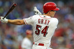 Cincinnati Reds' Sonny Gray hits a two-run RBI-single in the third inning of a baseball game against the Chicago Cubs, Saturday, Aug. 10, 2019, in Cincinnati. (AP Photo/Aaron Doster)