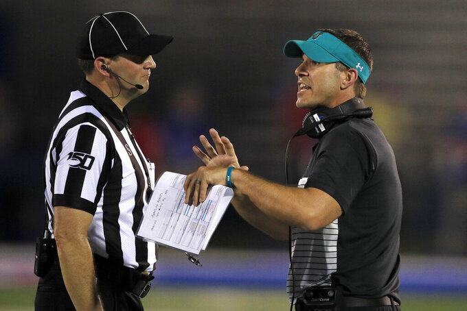 Coastal Carolina head coach Jamey Chadwell, right, talks with side judge Rick Ockey, left, during the second half of an NCAA college football game against Kansas in Lawrence, Kan., Saturday, Sept. 7, 2019. (AP Photo/Orlin Wagner)