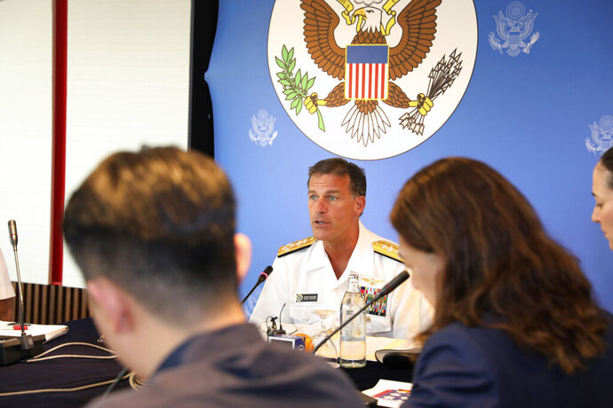 In this photo released by U.S. Embassy in Bangkok, U.S. Navy's Pacific Fleet Commander Adm. John Aquilino talks to reporters during an interview at U.S Embassy in Bangkok, Thailand, Friday, Dec. 13, 2019. China's activities in territory it claims in the South China Sea are meant to intimidate other nations in the region, the commander said. Adm. Aquilino said China's actions, including constructing islands in the disputed waters, are intended to project its military capacity. (U.S. Embassy in Bangkok via AP)