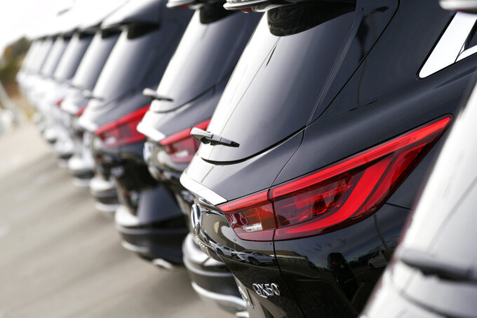 A row of unsold 2021 QX50 sports-utility vehicles sits at an Infiniti dealership, Sunday, Dec. 27, 2020, in Highlands Ranch, Colo. U.S. auto sales rose more than 11% in the first quarter, as strong March 2021 sales far outpaced 2020 when coronavirus pandemic began. (AP Photo/David Zalubowski)
