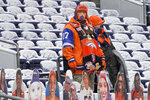 Denver Broncos fans look on before an NFL football game against the Kansas City Chiefs, Sunday, Oct. 25, 2020, in Denver. (AP Photo/Jack Dempsey)