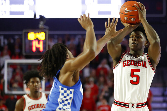Georgia's Anthony Edwards (5) takes a shot over Kentucky guard Tyrese Maxey (3) during the first half of an NCAA college basketball game in Athens, Ga., Tuesday, Jan. 7, 2020. (Joshua L. Jones/Athens Banner-Herald via AP)