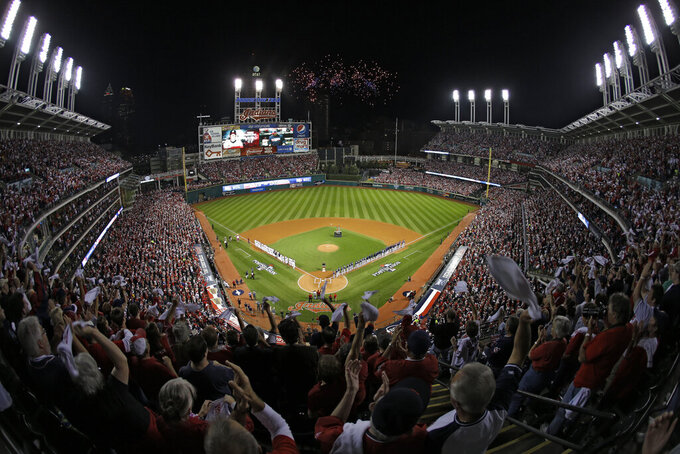 FILE - In this Oct. 2, 2013 file photo, fans in the upper deck wave towels as the Cleveland Indians and the Tampa Bay Rays are introduced for the AL wild-card baseball game at Progressive Field in Cleveland. The Cleveland Indians have agreed to a 15-year lease extension at Progressive Field, keeping them at their downtown ballpark through 2036 and ending speculation the franchise would relocate. The agreement, which was announced Thursday, Aug. 5, 2021, and still needs legislative approval, includes two additional five-year options that could make it a 25-year deal through 2046. (AP Photo/Mark Duncan, File)