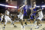 Vanderbilt forward Clevon Brown (15) pulls in a rebound under UNC Asheville's Coty Jude (22) in the first half of an NCAA college basketball game Monday, Dec. 31, 2018, in Nashville, Tenn. (AP Photo/Mark Humphrey)
