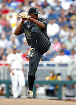 Vanderbilt pitcher Kumar Rockeer (80) throws against Michigan in the first inning of Game 2 of the NCAA College World Series baseball finals in Omaha, Neb., Tuesday, June 25, 2019. (AP Photo/John Peterson)