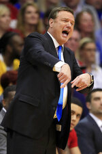 Kansas coach Bill Self gestures during the first half of the team's NCAA college basketball game against TCU in Lawrence, Kan., Wednesday, March 4, 2020. (AP Photo/Orlin Wagner)
