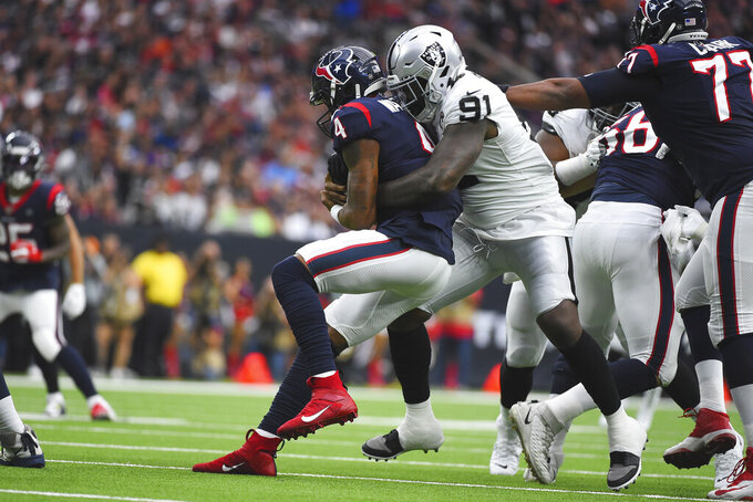 Houston Texans quarterback Deshaun Watson (4) is hit by Oakland Raiders defensive end Benson Mayowa (91) during the first half of an NFL football game Sunday, Oct. 27, 2019, in Houston. (AP Photo/Eric Christian Smith)