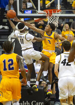 Morehead State's James Baker, right, fouls Missouri's Mario McKinney Jr., left, during the first half of an NCAA college basketball game Wednesday, Nov. 20, 2019, in Columbia, Mo. (AP Photo/L.G. Patterson)