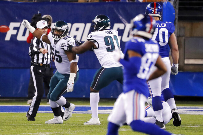 Philadelphia Eagles defensive end Brandon Graham (55) celebrates with Eagles defensive tackle Fletcher Cox (91) after sacking New York Giants quarterback Daniel Jones (8) in the first half of an NFL football game, Sunday, Dec. 29, 2019, in East Rutherford, N.J. (AP Photo/Seth Wenig)