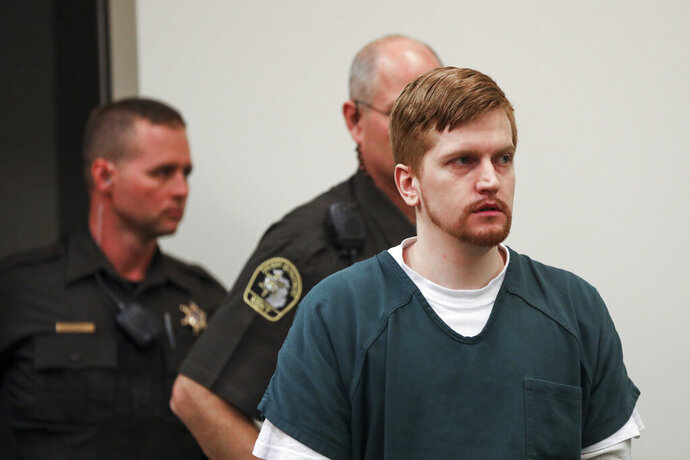 Jared Chance enters the courtroom for his sentencing in Kent County Circuit Court,  Thursday, Oct. 10, 2019, in Grand Rapids, Mich. Chance, a Michigan man convicted of killing and dismembering Ashley Young has been sentenced to at least 100 years in prison after a judge called his actions