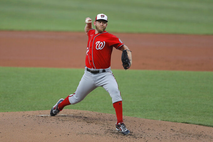 Washington Nationals starting pitcher Stephen Strasburg delivers a pitch to the Baltimore Orioles during an exhibition baseball game, Monday, July 20, 2020, in Baltimore. (AP Photo/Julio Cortez)