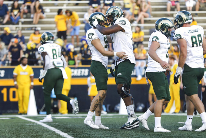 Colorado State's Cayden Camper, left, and Keith Williams celebrate Camper's field goal against Toledo during an NCAA college football game in Toledo, Ohio, Saturday, Sept. 18, 2021. (Rebecca Benson/The Blade via AP)
