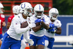 Indianapolis Colts running back Jonathan Taylor runs a drill during practice at the NFL team's football training camp in Westfield, Ind., Wednesday, July 28, 2021. (AP Photo/Michael Conroy)