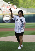 Former LPGA golfer Nancy Lopez throws out a ceremonial first pitch before a baseball game between the St. Louis Cardinals and the Chicago White Sox in Chicago, Wednesday, July 11, 2018. (AP Photo/Nam Y. Huh)