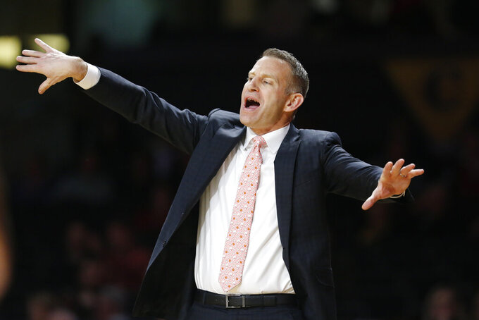 FILE - In this Jan. 22, 2020, file photo, Alabama coach Nate Oats gestures to players during the second half of an NCAA college basketball game against Vanderbilt in Nashville, Tenn. Oats brought points galore in his first season at Alabama with his up-tempo coaching style. Now, he's hoping the defense--and wins--will follow. (AP Photo/Mark Humphrey)