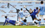 Chelsea's Marcos Alonso scores the winning goal during the English Premier League soccer match between Manchester City and Chelsea at the Etihad Stadium in Manchester, Saturday, May 8, 2021.(Martin Rickett/Pool via AP)