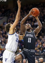Providence guard Alpha Diallo (11) takes a shot over Villanova forward Jeremiah Robinson-Earl (24) during the second half of an NCAA college basketball game, Saturday, Feb. 29, 2020, in Philadelphia, Pa. Providence won 58-54. (AP Photo/Laurence Kesterson)