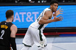 Milwaukee Bucks forward Giannis Antetokounmpo (34) reacts after dunking, next to Brooklyn Nets forward Blake Griffin (2) during the first half of Game 5 of a second-round NBA basketball playoff series Tuesday, June 15, 2021, in New York. (AP Photo/Kathy Willens)