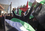 Palestinian protesters wave national flags and chant angry slogans during a protest against the U.S. Mideast peace plan, in Gaza City, Monday, Jan. 28, 2020. U.S. President Donald Trump is set to unveil his administration's much-anticipated Mideast peace plan in the latest U.S.  venture to resolve the Israeli-Palestinian conflict. (AP Photo/Khalil Hamra)