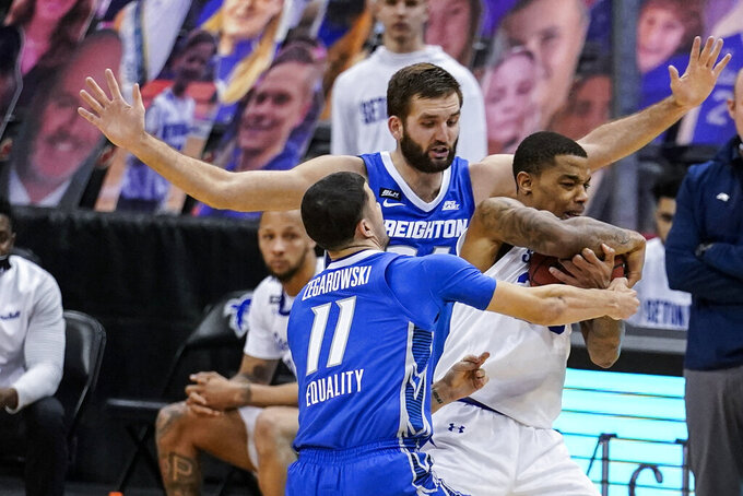 Creighton's Marcus Zegarowski (11) and Mitch Ballock (24) trap Seton Hall's Shavar Reynolds (33) during the second half of an NCAA college basketball game Wednesday, Jan. 27, 2021, in Newark, N.J. Creighton won 85-81. (AP Photo/Frank Franklin II)