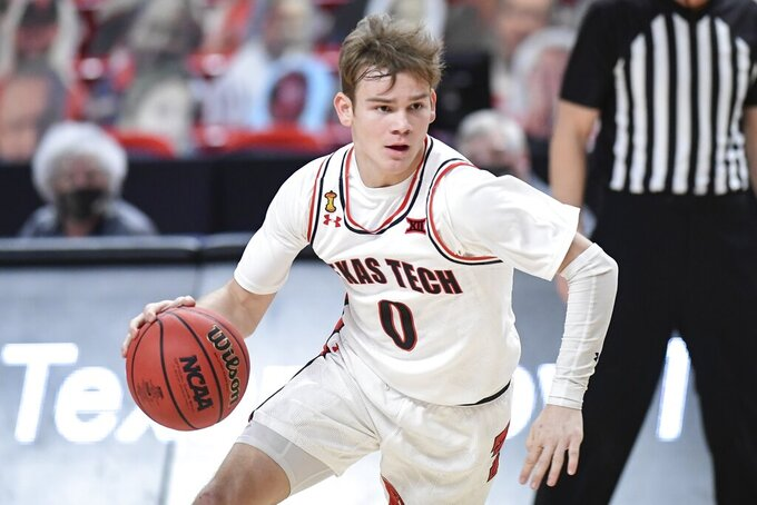 FILE - In this March 4, 2021, file photo, Texas Tech's Mac McClung (0) controls the ball during the first half of an NCAA college basketball game against Iowa State in Lubbock, Texas. McClung is a member of The AP All-Big 12 first team, announced Tuesday, March 9, 2021. (AP Photo/Justin Rex, File)