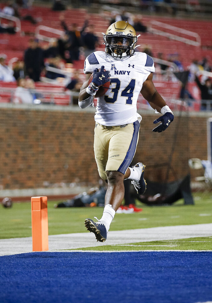 Navy fullback Jamale Carothers scores a touchdown during the second half of the team's NCAA college football game against SMU, Saturday, Oct. 31, 2020, in Dallas. (AP Photo/Brandon Wade)