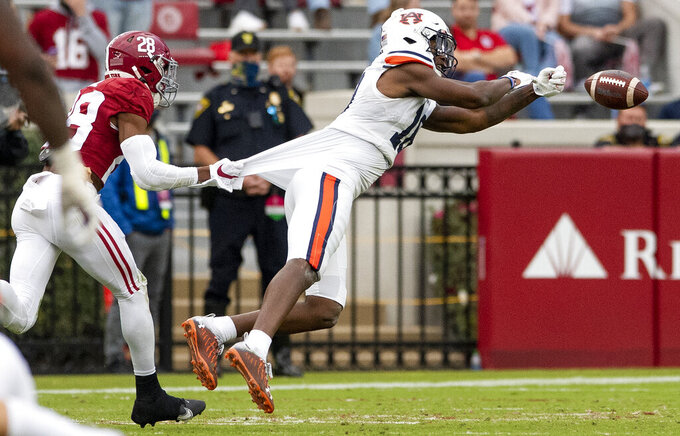A pass goes off the hands of Auburn wide receiver Seth Williams (18) as Alabama defensive back Josh Jobe (28) defends during an NCAA college football game Saturday, Nov. 28, 2020, in Tuscaloosa, Ala. (Mickey Welsh/The Montgomery Advertiser via AP)