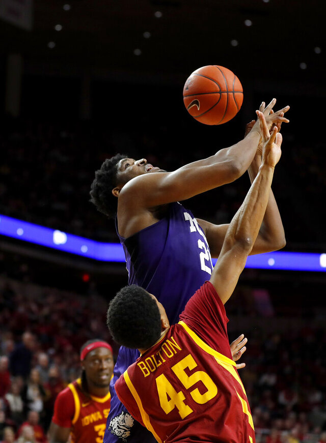 Iowa State guard Rasir Bolton, bottom, breaks up a shot by TCU center Kevin Samuel, top, during the second half of an NCAA college basketball game, Tuesday, Feb. 25, 2020, in Ames, Iowa. Iowa State won 65-59. (AP Photo/Matthew Putney)