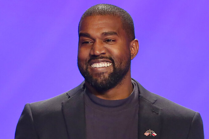 """FILE - In this Nov. 17, 2019, file photo, Kanye West appears on stage during a service at Lakewood Church in Houston. West is scheduled to unveil his 10th studio album, """"Donda,"""" named after his late mother, at a listening party Thursday, July 22, 2021, at Mercedes Benz Stadium in Atlanta. (AP Photo/Michael Wyke, File)"""
