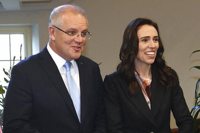 New Zealand's Prime Minister Jacinda Ardern, right, arrives with Australian Prime Minister Scott Morrison before bilateral talks in Melbourne, Australia, Friday, July 19, 2019. (Julian Smith/Pool Photo via AP)