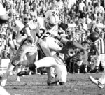 "FILE - In this Jan. 9, 1977, file photo, Minnesota Vikings wide receiver Sammy White losing his helmet after being hit by Oakland Raiders Jack tatum (32) and Skip Thomas, rear, during the Super Bowl XI football game in Pasadena, Calif. ""The Assassin"" _ Defensive back Jack Tatum was known for his fierce and intimidating hits for the Oakland Raiders in 1970s. (AP Photo/Richard Drew, File)"