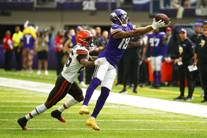Minnesota Vikings wide receiver Justin Jefferson (18) catches a pass over Cleveland Browns cornerback Greedy Williams (26) during the second half of an NFL football game, Sunday, Oct. 3, 2021, in Minneapolis. (AP Photo/Bruce Kluckhohn)