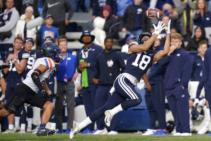 BYU wide receiver Gunner Romney (18) catches a pass as Boise State cornerback Kaonohi Kaniho, left, defends in the second half during an NCAA college football game Saturday, Oct. 9, 2021, in Provo, Utah. (AP Photo/Rick Bowmer)