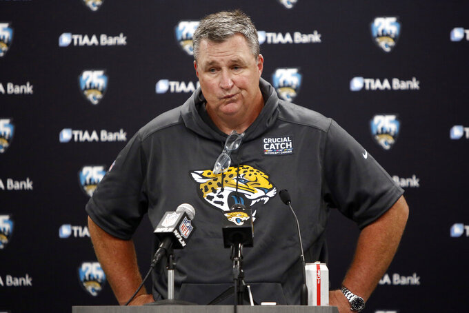 Jacksonville Jaguars head coach Doug Marrone speaks to members of the media following an NFL football game against the Carolina Panthers in Charlotte, N.C., Sunday, Oct. 6, 2019. (AP Photo/Brian Blanco)