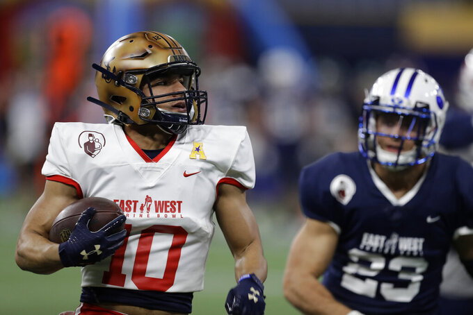 East wide receiver Malcolm Perry, of Navy, (10) runs past West safety Austin Lee, of BYU, (23) for a touchdown during the second half of the East West Shrine football game Saturday, Jan. 18, 2020, in St. Petersburg, Fla. (AP Photo/Chris O'Meara)