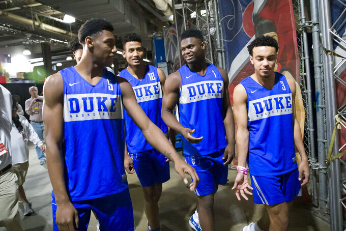 From left to right, Duke forward RJ Barrett,  forward Javin DeLaurier, forward Zion Williamson, and guard Tre Jones walk after an NCAA men's college basketball news conferences in Washington, Saturday, March 30, 2019. Duke plays Michigan State in the East Regional final game on Sunday.(AP Photo/Alex Brandon)