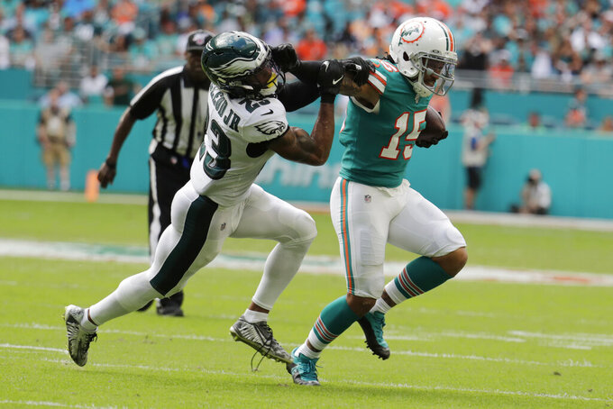 Miami Dolphins wide receiver Albert Wilson (15) strong arms Philadelphia Eagles free safety Rodney McLeod Jr. (23), during the first half at an NFL football game, Sunday, Dec. 1, 2019, in Miami Gardens, Fla. (AP Photo/Lynne Sladky)
