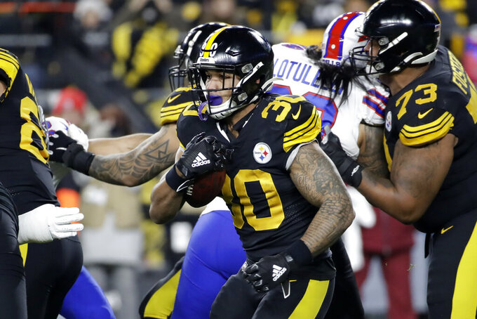 Pittsburgh Steelers running back James Conner (30) carries the ball during the first half of an NFL football game against the Buffalo Bills in Pittsburgh, Sunday, Dec. 15, 2019. (AP Photo/Don Wright)