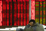 In this Thursday, Dec. 12, 2019, photo, an investor monitors stock prices at a brokerage in Beijing. Shares likewise jumped Friday, Dec. 13, 2019 in Asia following fresh all-time highs overnight on Wall Street spurred by optimism that the U.S. and China are close to reaching a deal to end their costly trade war. (AP Photo/Ng Han Guan)