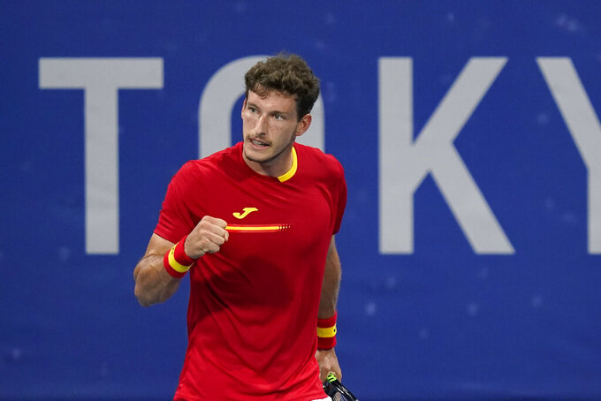 Pablo Carreno Busta, of Spain, reacts during a tennis match against Tennys Sandgren, of the United States, at the 2020 Summer Olympics, Saturday, July 24, 2021, in Tokyo, Japan. (AP Photo/Patrick Semansky)