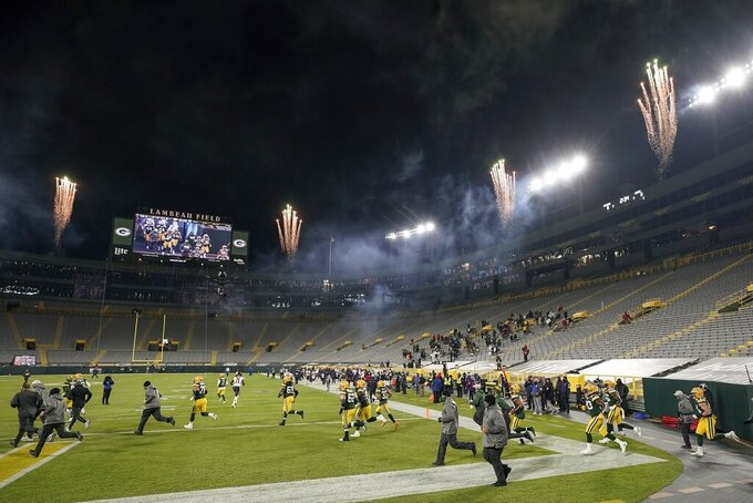 Green Bay Packers players take the field before an NFL football game against the Chicago Bears Sunday, Nov. 29, 2020, in Green Bay, Wis. (AP Photo/Morry Gash)