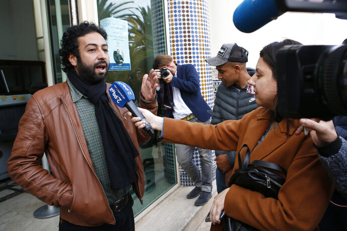 FILE - In this March 5, 2020 file photo, journalist and activist Omar Radi speaks to the media after his hearing at the Casablanca Courthouse, In Casablanca, Morocco. Amnesty International says sophisticated telephone surveillance software appears to have been used to spy on journalist-activist Omar Radi in Morocco, in a continuing crackdown on dissent in the North African kingdom. (AP Photo/Abdeljalil Bounhar, File)
