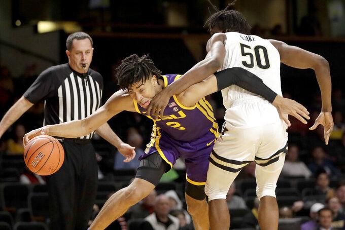 LSU forward Trendon Watford (2) drives against Vanderbilt forward Ejike Obinna (50) in the first half of an NCAA college basketball game Wednesday, Feb. 5, 2020, in Nashville, Tenn. (AP Photo/Mark Humphrey)