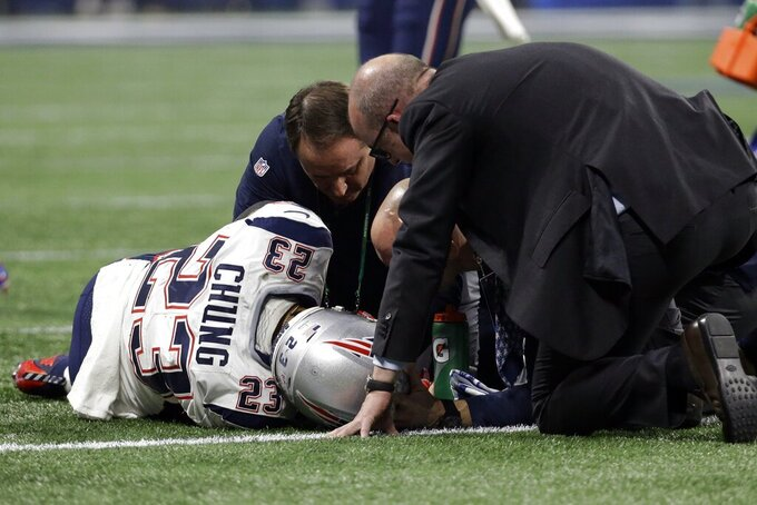 New England Patriots' Patrick Chung (23) is tended to after he injured his right arm during the second half of the NFL Super Bowl 53 football game against the Los Angeles Rams Sunday, Feb. 3, 2019, in Atlanta. (AP Photo/Mark Humphrey)