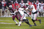 Georgia running back James Cook (4) carries the ball for a touchdown during the first half of the team's NCAA college football game against South Carolina on Saturday, Nov. 28, 2020, in Columbia, S.C. (AP Photo/Sean Rayford)