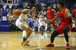 Rhode Island's Rhode Island's Jeff Dowtin (11) makes a move to the basket as Dayton's Ibi Watson (2) defends during the second half of an NCAA college basketball game Wednesday, March 4, 2020, in Kingston, R.I. (AP Photo/Stew Milne)