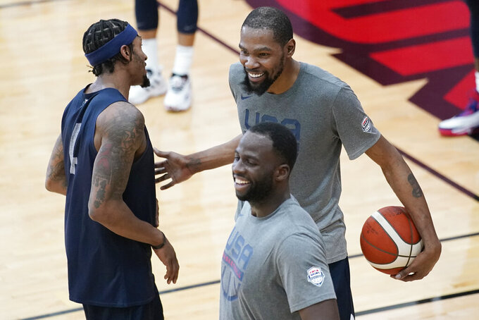 Bradley Beal, left, and Kevin Durant, right smile during practice for USA Basketball, Wednesday, July 7, 2021, in Las Vegas. (AP Photo/John Locher)