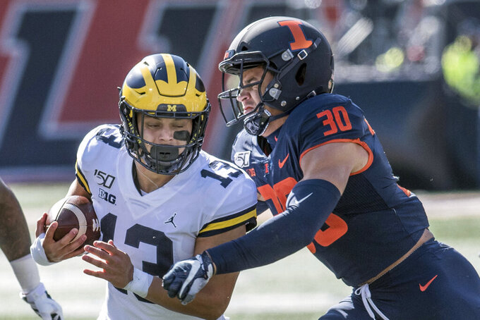 No. 16 Michigan needs late surge to hold off Illinois 42-25