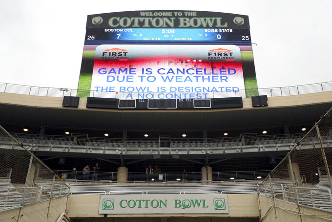The First Responder Bowl between Boston College and Boise State was canceled due to weather and was designated a no contest after multiple lighting delays Wednesday, Dec. 26, 2018, in Dallas. (AP Photo/Richard W. Rodriguez)